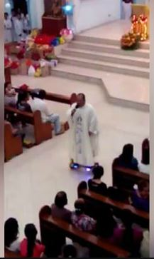 The Priest seen riding on a hoverbaord